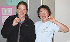 Georgina and Aiko show off their new key chains. Georgina made hers in English for Aiko and Aiko mad